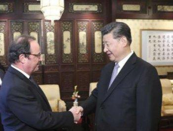 习近平会见法国前总统奥朗德